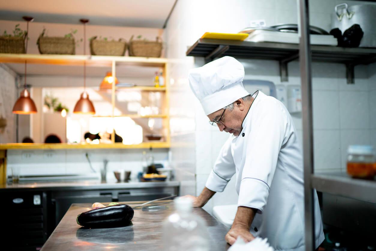 A chef in empty kitchen