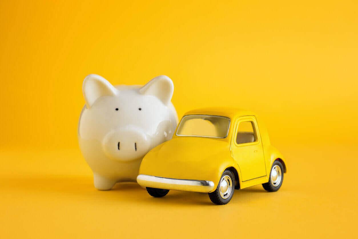 Piggy bank next to yellow toy car