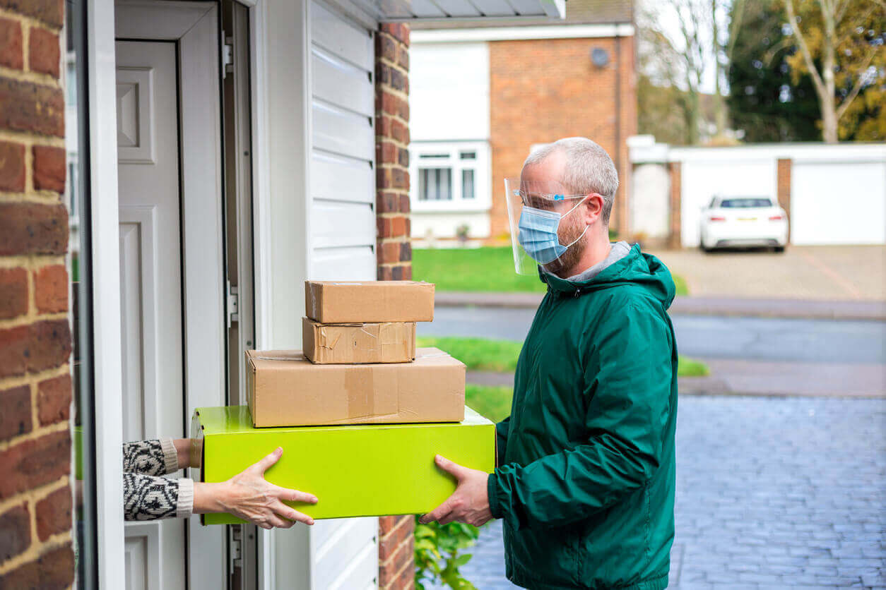 Delivery driver handing parcels over