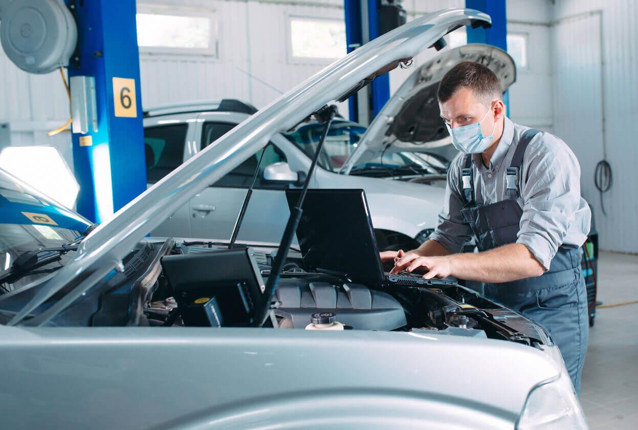 A mechanic checking over a car