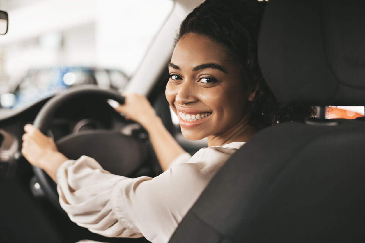 Young female driver smiling