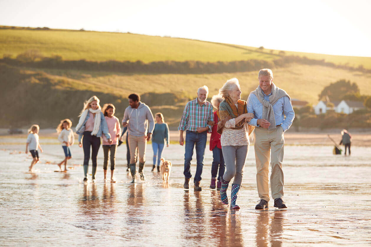 A large family walking across the beach