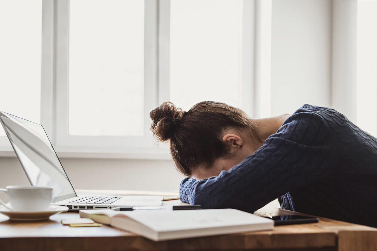 A woman feeling stressed by her laptop