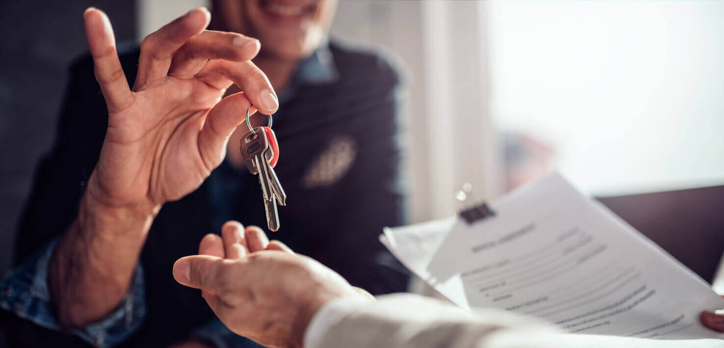 A tenant receiving house keys