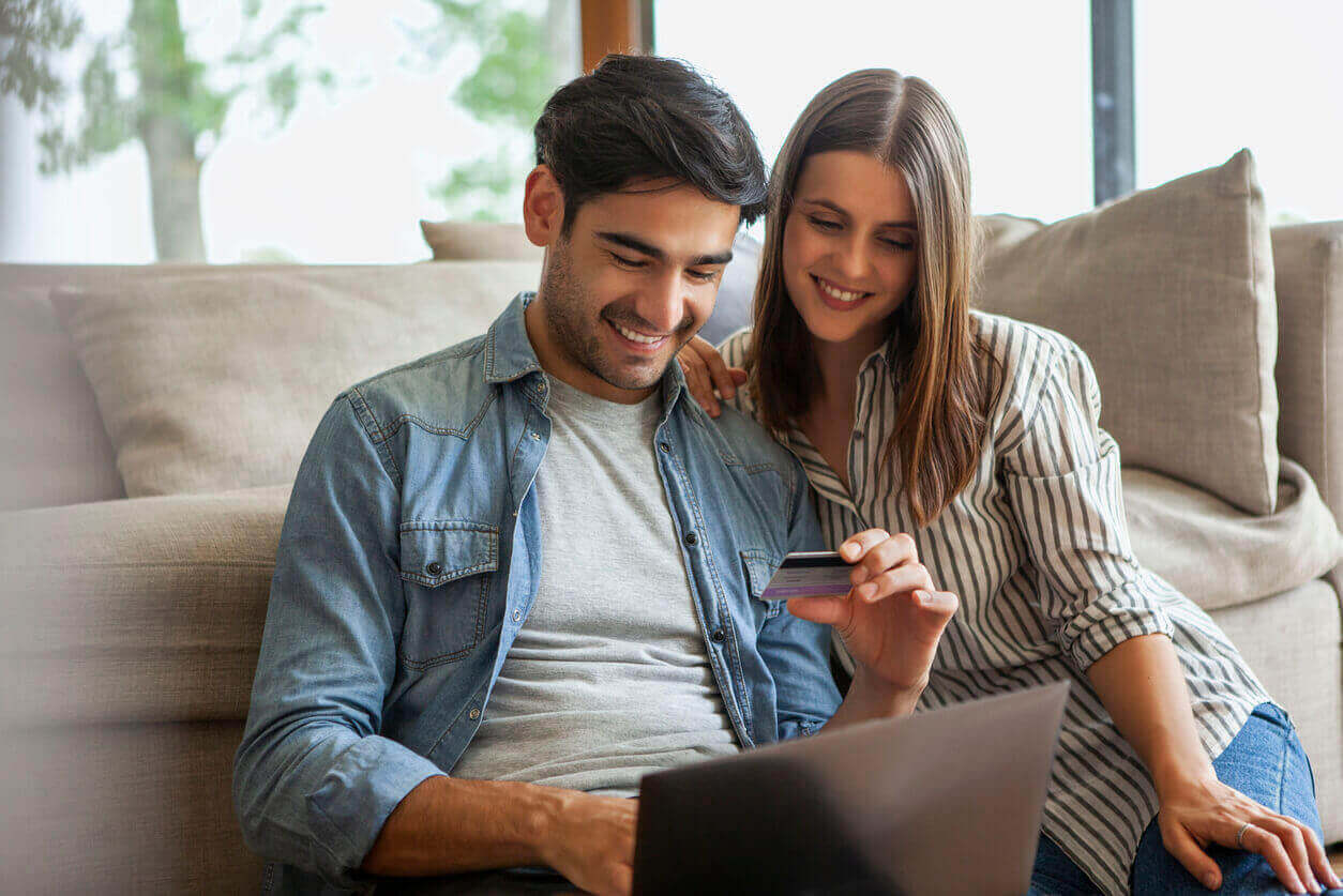 A couple using their joint credit card together