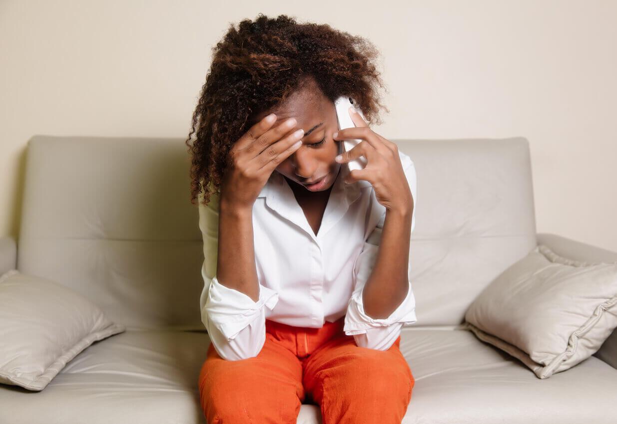 An upset woman on the phone