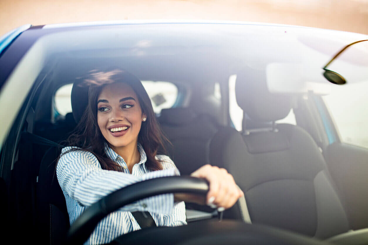 A young driver looking happy