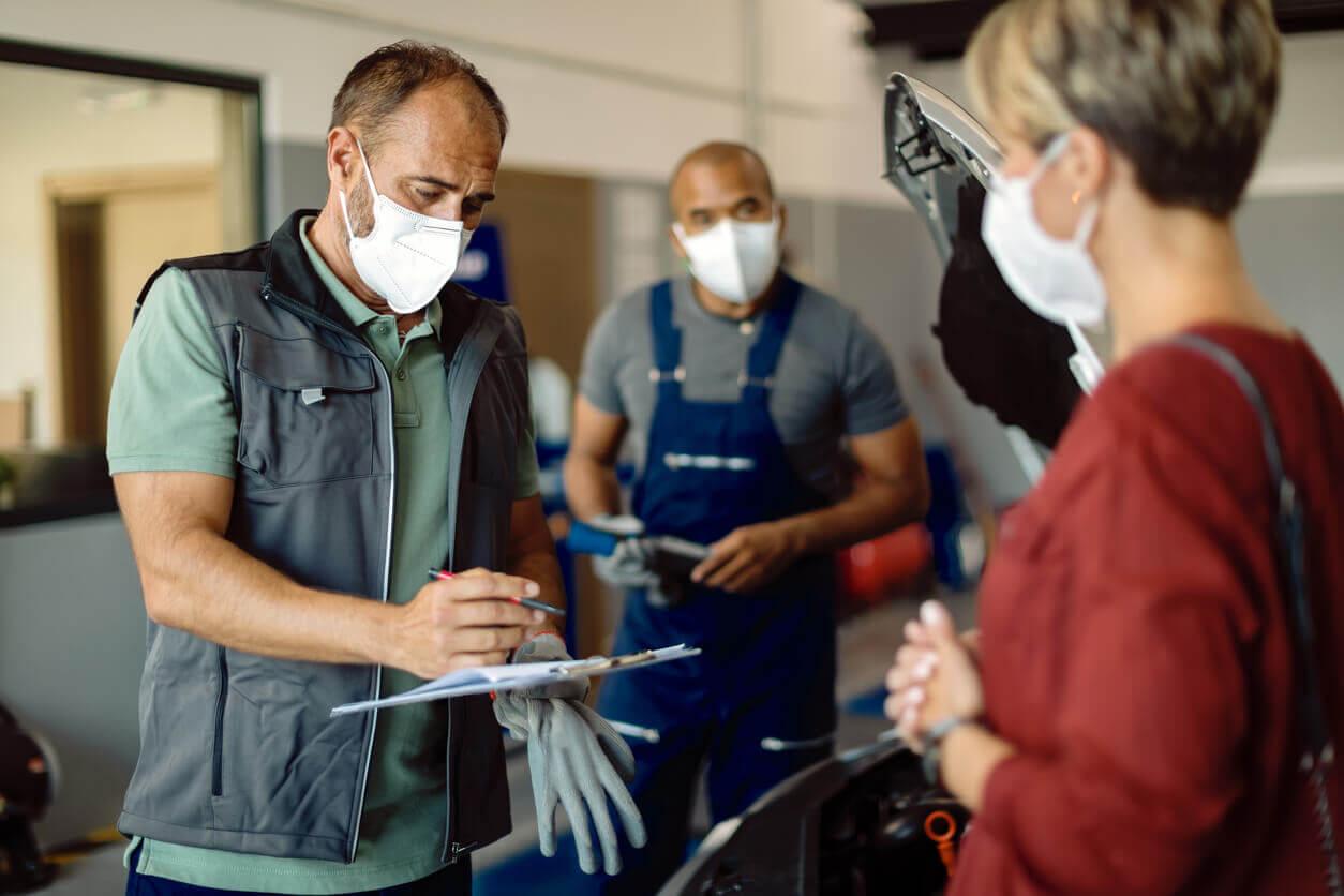 Mechanics and customer speaking after MOT