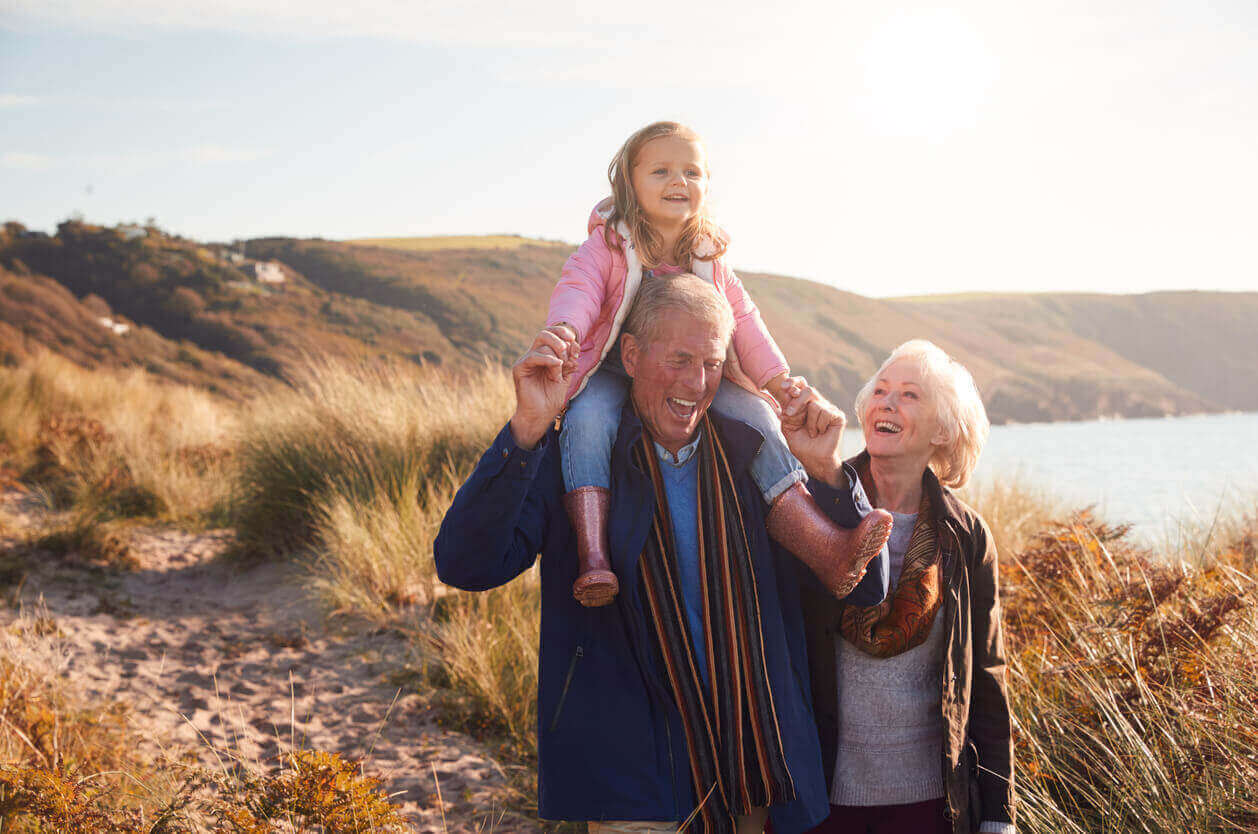 Grandparents with their grandchild on the beach