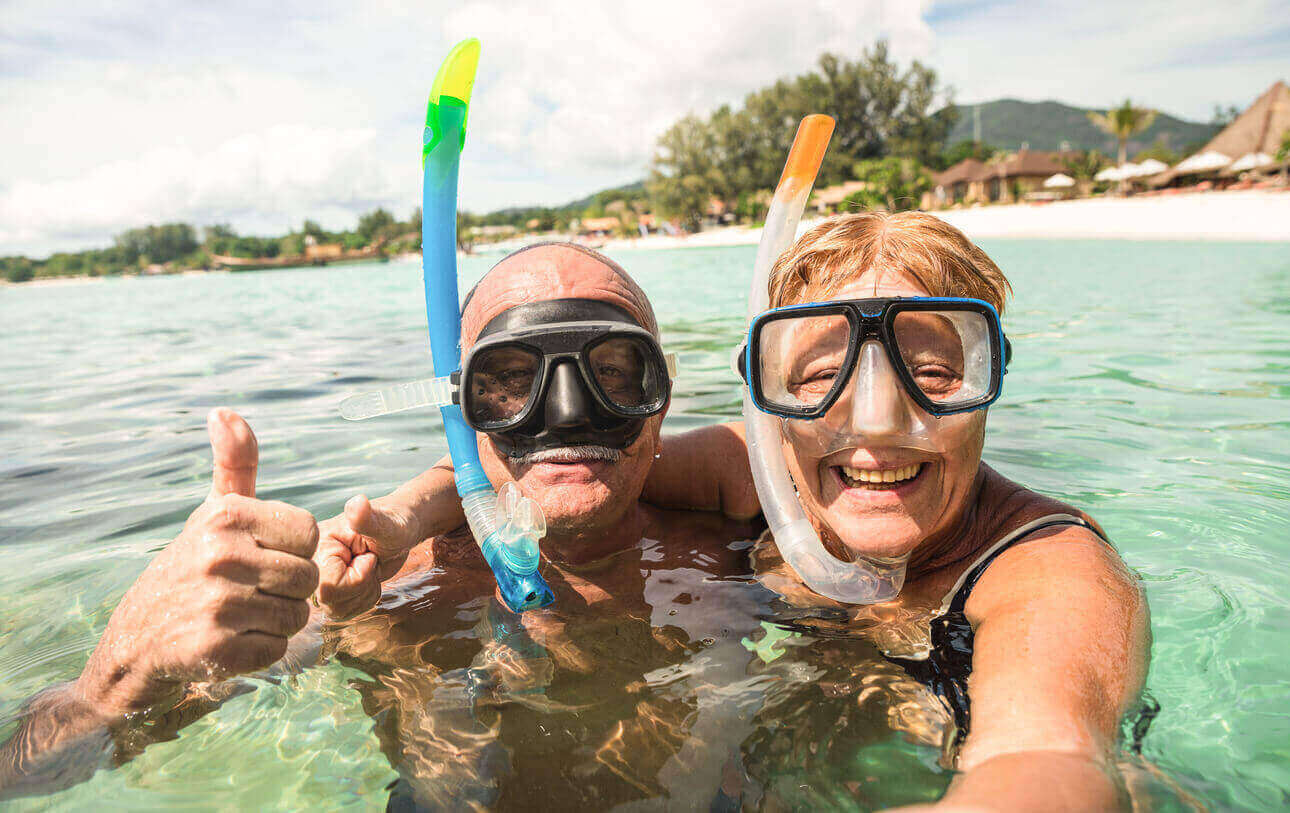 A couple snorkeling on holiday