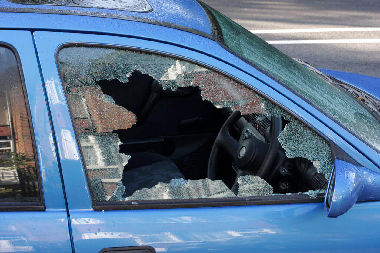 Blue car with smashed window