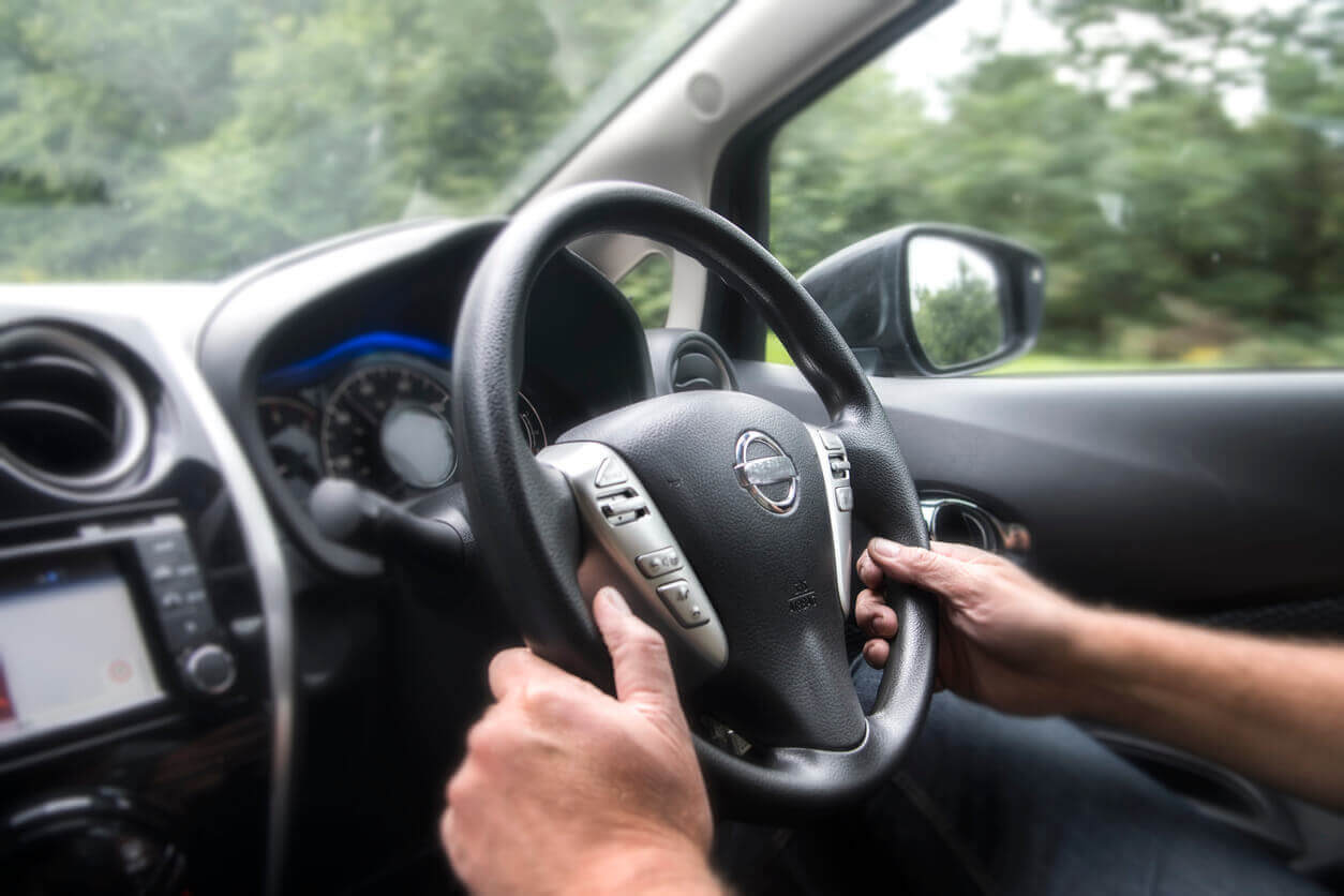 Closeup of driver's hands on steering wheel