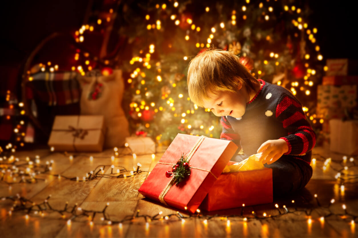 Young boy opening Christmas presents.