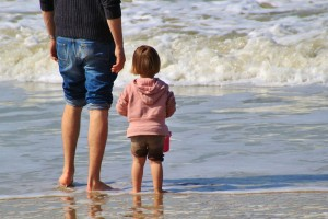 child and parent on beach