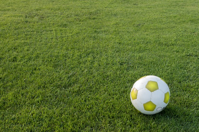 football on grassy sports field