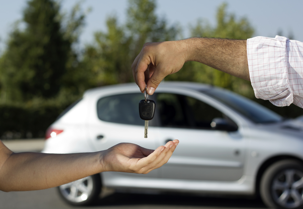Handing over keys to car after selling
