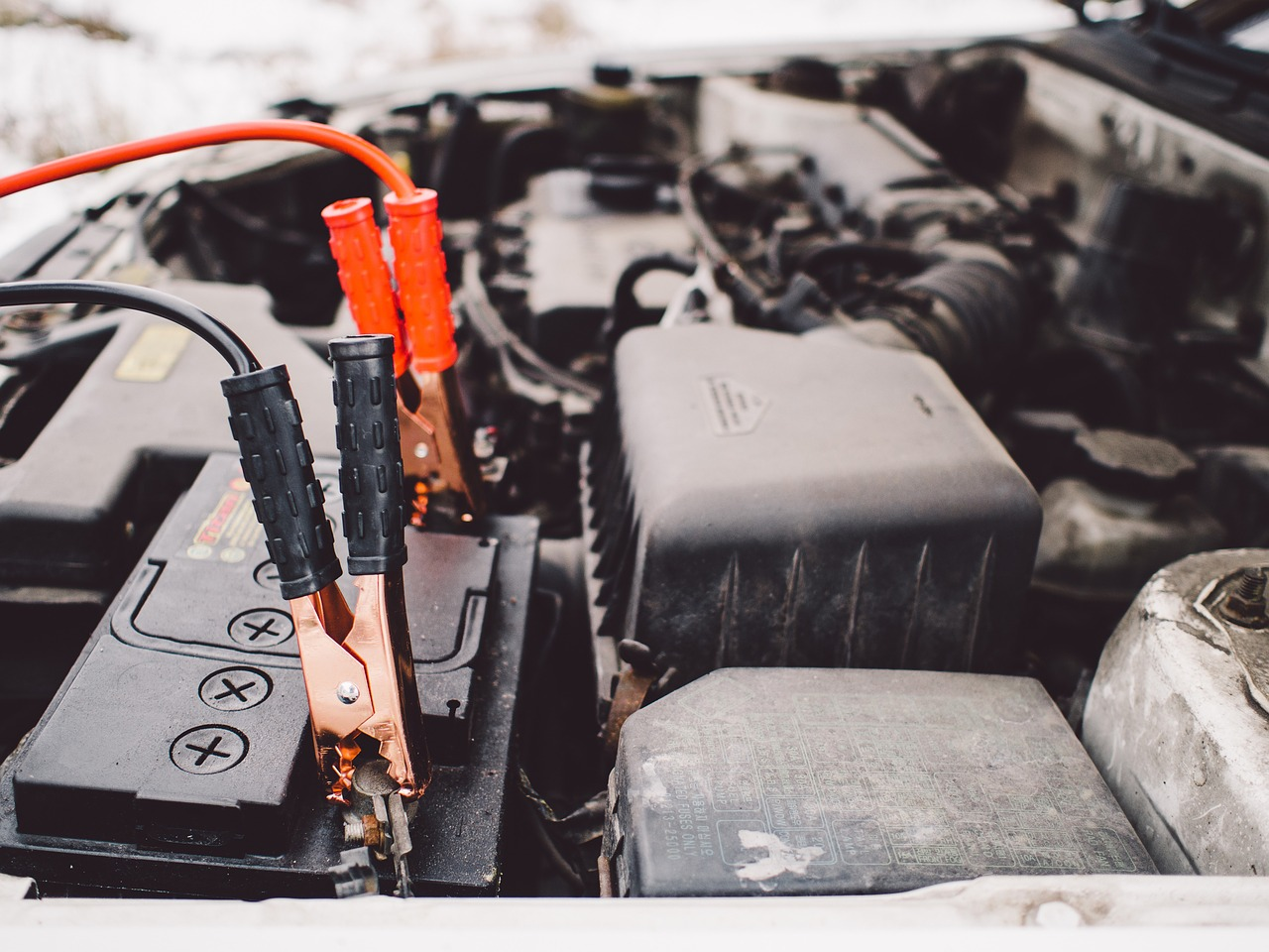 car battery with jump leads attached