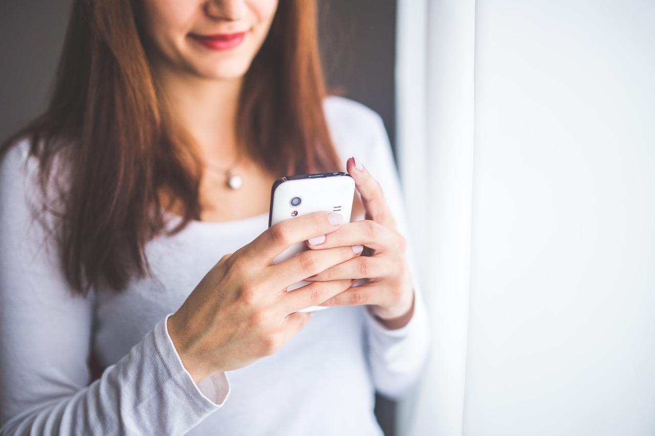 woman on phone app
