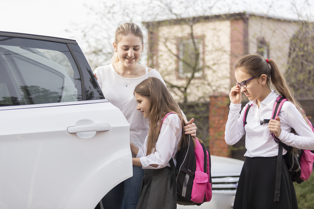 schoolgirls getting into car