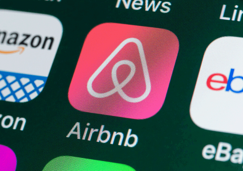 The airbnb app on ipad screen.