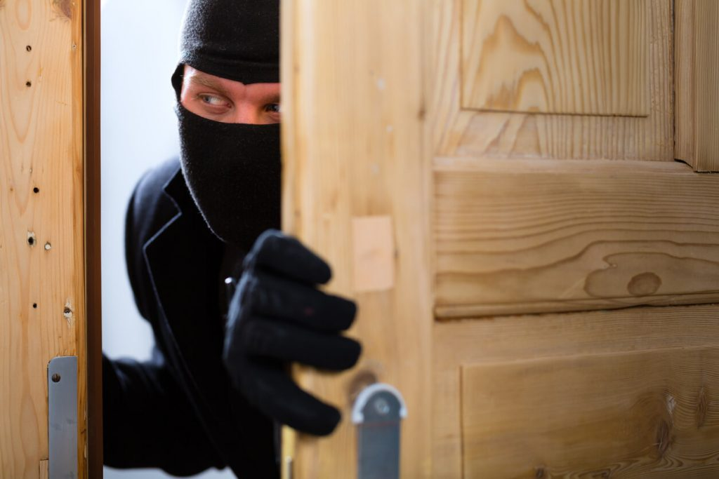 Thief trying to get into someone's home