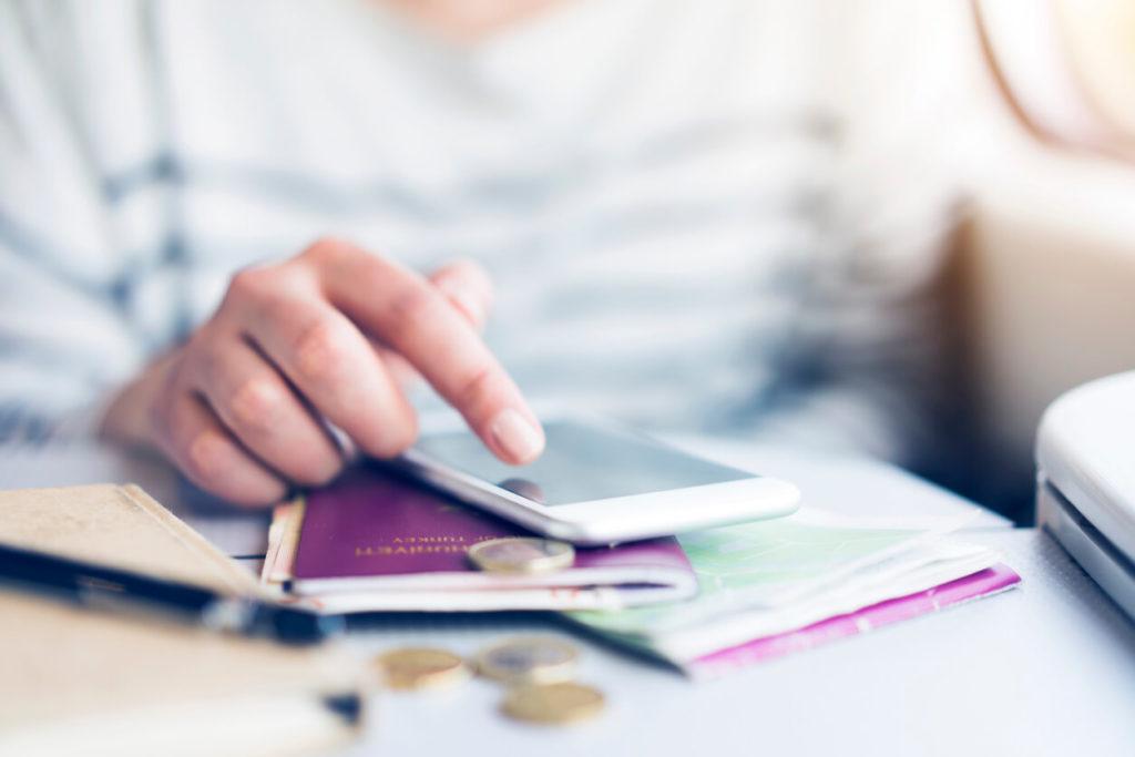 A person organising their travel money