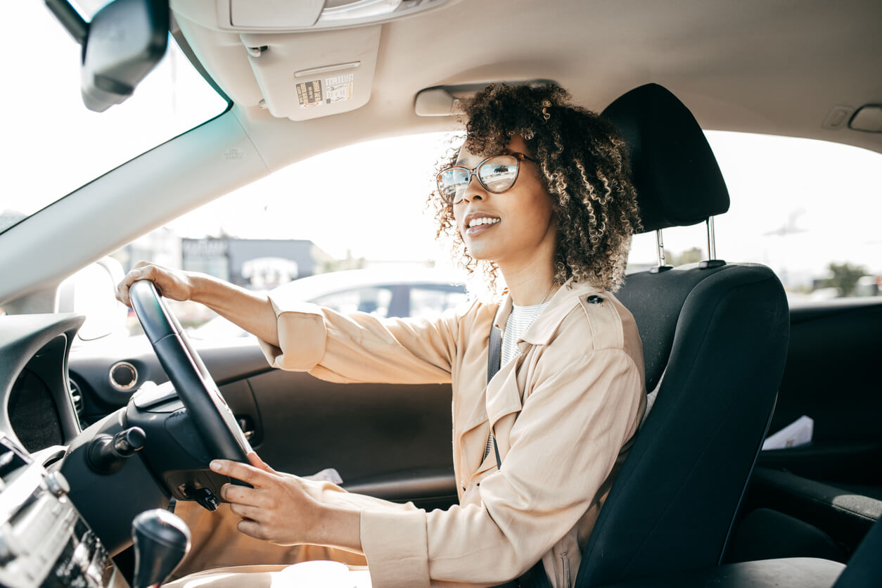 Young female driver driving