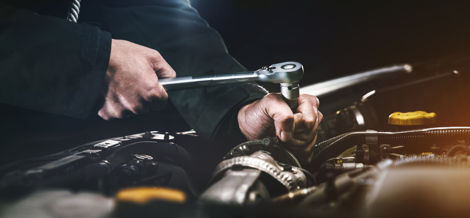 A mechanic working on a car