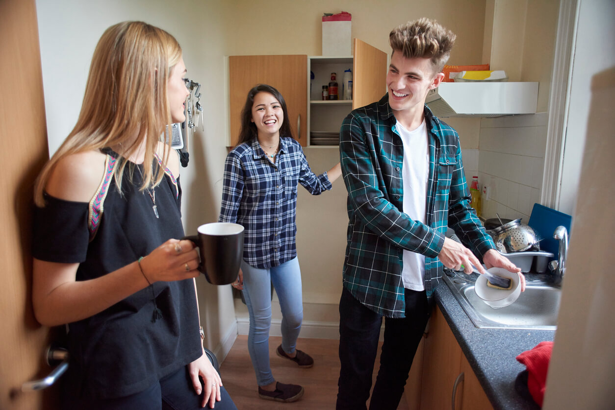 Students laughing and talking in the kitchen
