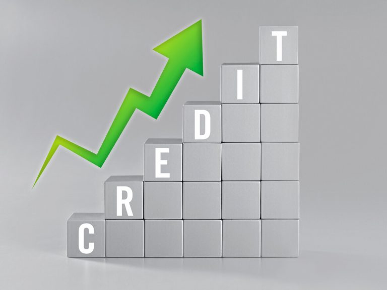 Concept image showing an arrow going upwards alongside the word credit.