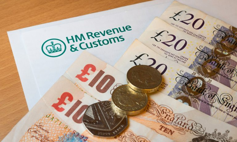 English money on top of HM Revenue and Customs letter