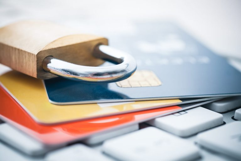 Credit cards on a laptop with a padlock on top