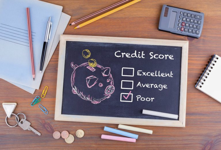 Poor credit score next to piggy bank on chalk board