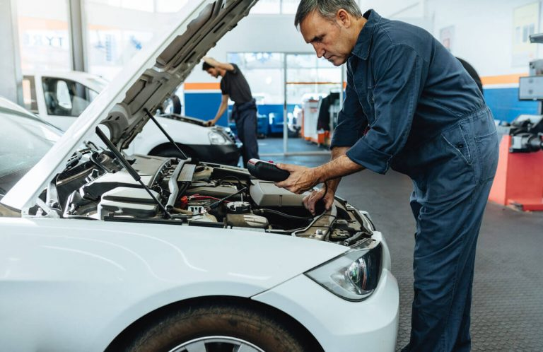A mechanic working on a car's engine