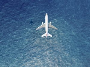 Aeroplane flying over the sea
