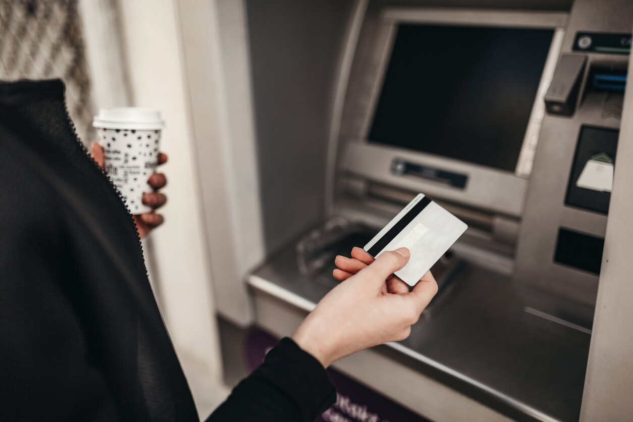 A woman using an ATM machine