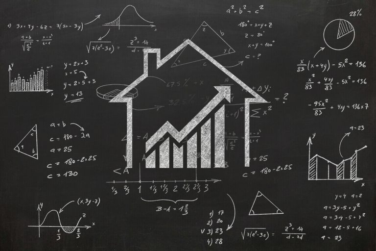 Picture of a house and calculations on chalk board