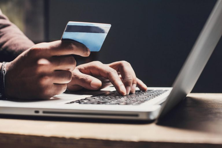 A man using his credit card online