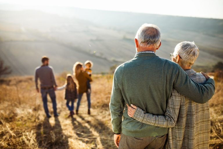 An elderly couple looking at their family