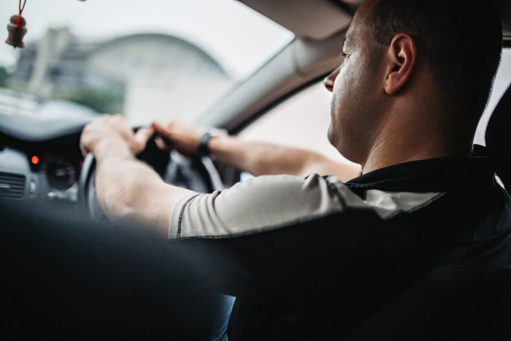 Close up of middle-aged man driving a car