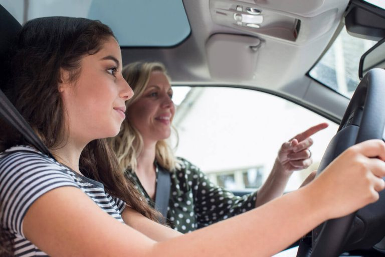 Teenager learning to drive with parent