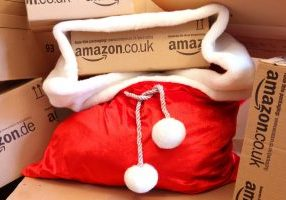 Amazon delivery box inside a red santa sack.