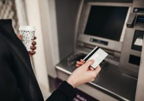 A woman using an ATM machine