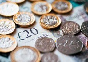 British pounds and twenty pound note