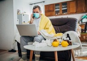 An ill man at home on his laptop
