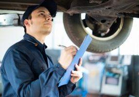 mechanic inspecting car during MOT test