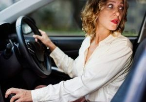 woman reversing looking backwards